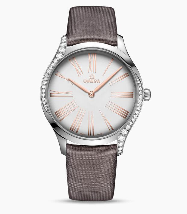 The brown fabric strap fitted with the diamonds bezel, along with the rose gold hands show the elegance and luxury perfectly.