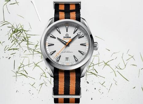 The orange and black NATO strap matches the black and orange elements on the dial well.