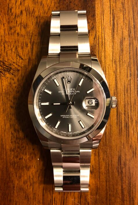 Swiss Rolex fake watches are elegant for men with grey color.